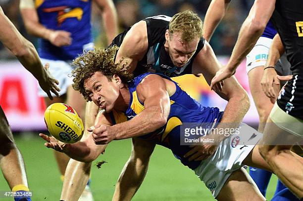 Matt Priddis of the Eagles handballs uring the round six AFL match between the Port Adelaide Power and the West Coast Eagles at Adelaide Oval on May...