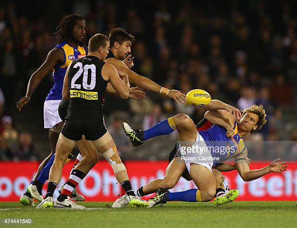 Matt Priddis of the Eagles is tackled during the round eight AFL match between the St Kilda Saints and the West Coast Eagles at Etihad Stadium on May...