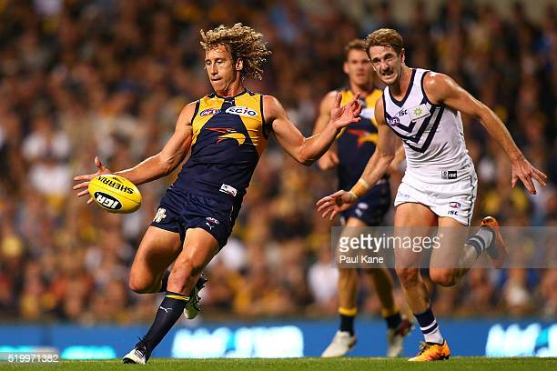Matt Priddis of the Eagles kicks the ball into the forward line during the round three AFL match between the West Coast Eagles and the Fremantle...