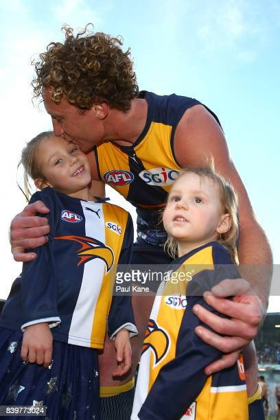 Matt Priddis of the Eagles shares a moment with his children after winning the round 23 AFL match between the West Coast Eagles and the Adelaide...