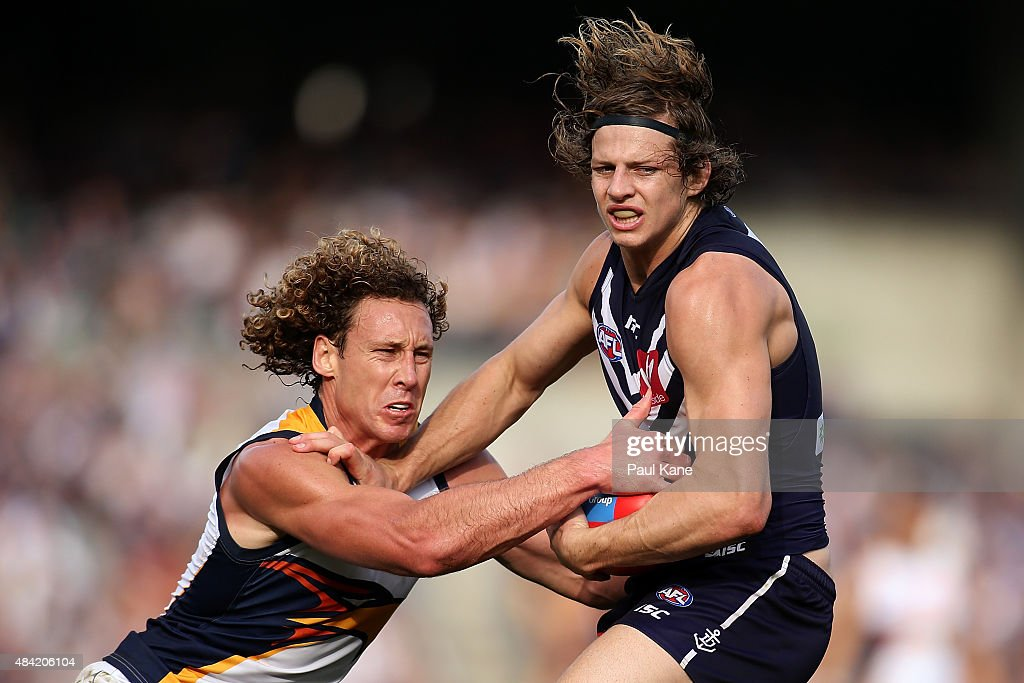 Matt Priddis of the Eagles tackles Nathan Fyfe of the Dockers during the round 20 AFL match between the Fremantle Dockers and the West Coast Eagles at Domain Stadium on August 16, 2015 in Perth, Australia.