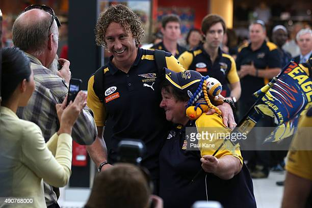 Matt Priddis of the West Coast Eagles is hugged by a supporter prior to departure to Melbourne for the 2015 AFL Grand Final at teh Perth Domestic...