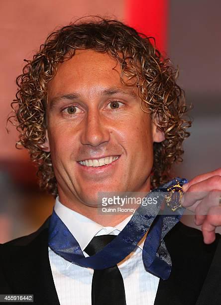 Matt Priddis of the West Coast Eagles poses with the 2014 Brownlow Medal at the 2014 Brownlow Medal Dinner at Crown Palladium on September 22, 2014...