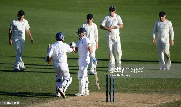 Matt Prior and Monty Panesar celebrates after drawing the day five of the Third Test match between New Zealand and England at Eden Park on March 26...
