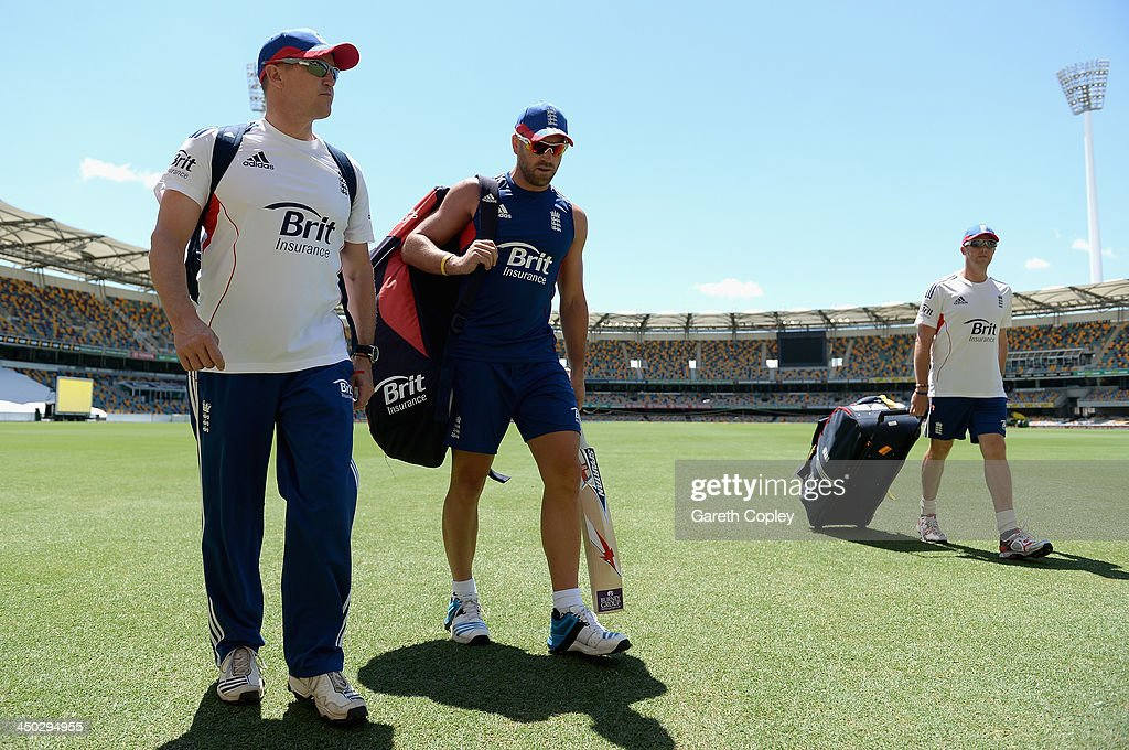 Matt Prior of England arrives for a nets session with coach Andy Flower and Graeme Swann at The Gabba on November 18, 2013 in Brisbane, Australia.