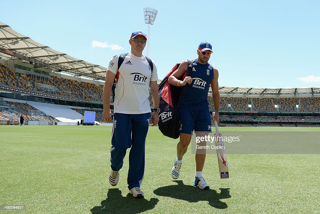 Matt Prior of England arrives for a nets session with coach Andy Flower at The Gabba on November 18, 2013 in Brisbane, Australia.