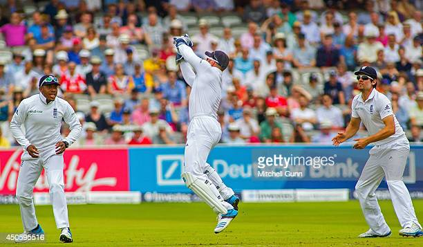 Matt Prior of England catches the ball to dismiss Kaushal Silva of Sri Lanka as Chris Jordan and Alastair Cook look on during the Investec 1st Test...