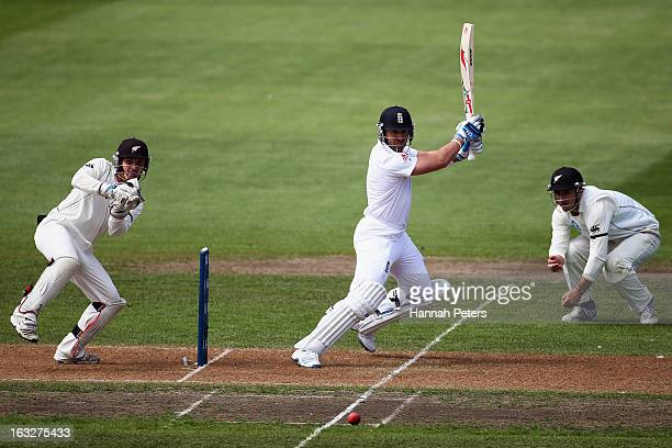 Matt Prior of England cuts the ball away for four runs during day two of the First Test match between New Zealand and England at University Oval on...