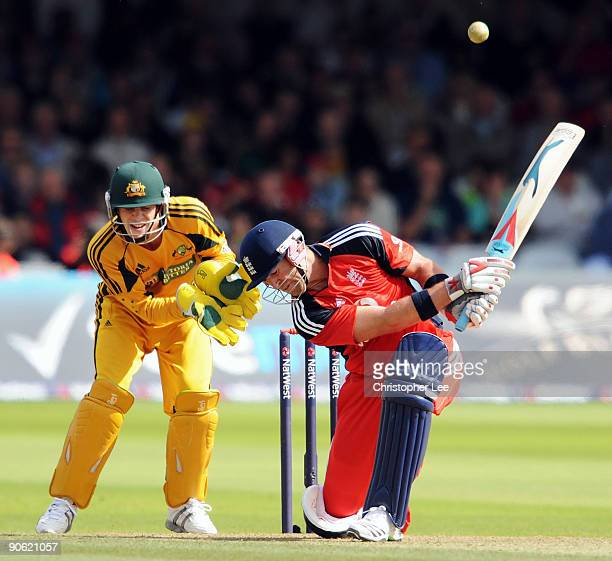 Matt Prior of England hits out watched by Tim Paine of Australia during the 4th NatWest One Day International between England and Australia at Lord's...
