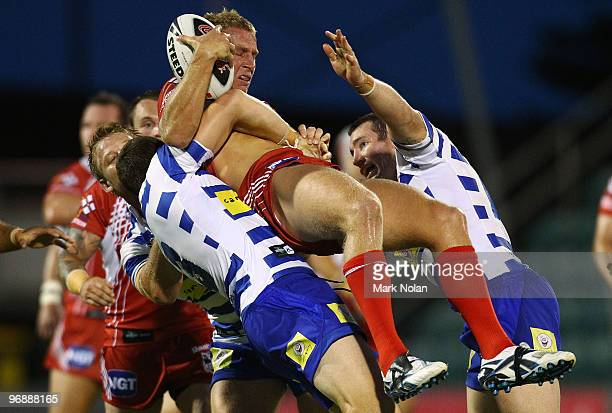 Matt Prior of the Dragons is tackled during the NRL trial match between the St George Illawarra Dragons and the Canterbury Bulldogs at WIN Stadium on...