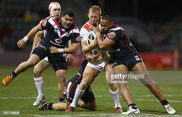 Matt Prior of the Dragons is tackled during the round 25 NRL match between the St George Dragons and the New Zealand Warriors at WIN Stadium on...