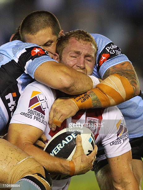 Matt Prior of the Dragons is tackled during the round two NRL match between the Cronulla Sharks and the St George Illawarra Dragons at Toyota Stadium...