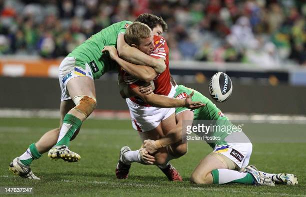 Matt Prior of the Dragons passes the ball during the round 17 NRL match between the Canberra Raiders and the St George Dragons at Canberra Stadium on...