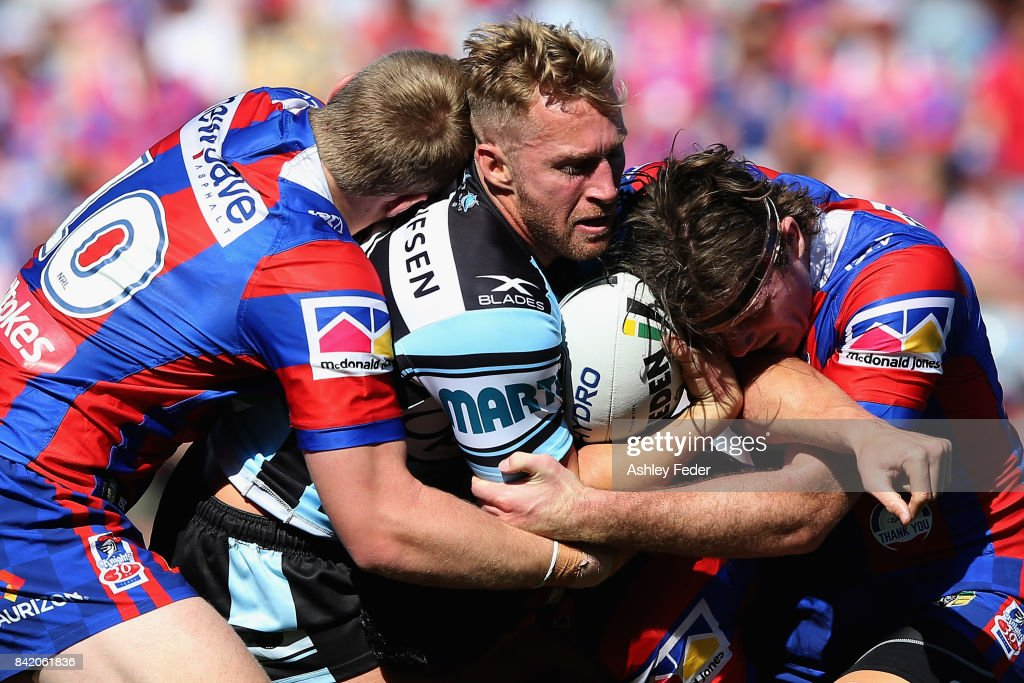 Matt Prior of the Sharks is tackled by Lachlan Fitzgibbon of the Knights during the round 26 NRL match between the Newcastle Knights and the Cronulla Sharks at McDonald Jones Stadium on September 3, 2017 in Newcastle, Australia.