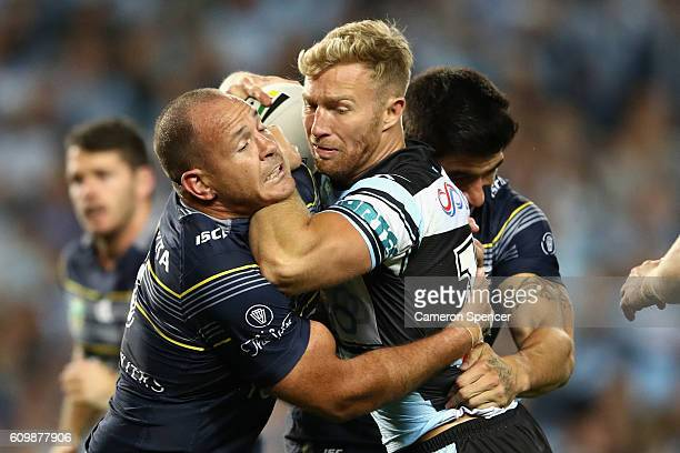 Matt Prior of the Sharks is tackled during the NRL Preliminary Final match between the Cronulla Sharks and the North Queensland Cowboys at Allianz...