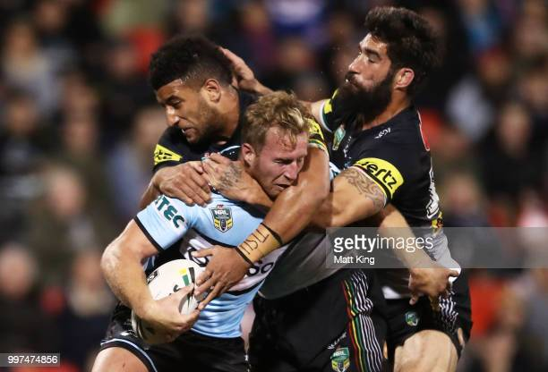 Matt Prior of the Sharks is tackled during the round 18 NRL match between the Panthers and the Sharks at Panthers Stadium on July 13 2018 in Penrith...