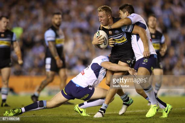 Matt Prior of the Sharks is tackled during the round eight NRL match between the Cronulla Sharks and the Gold Coast Titans at Southern Cross Group...