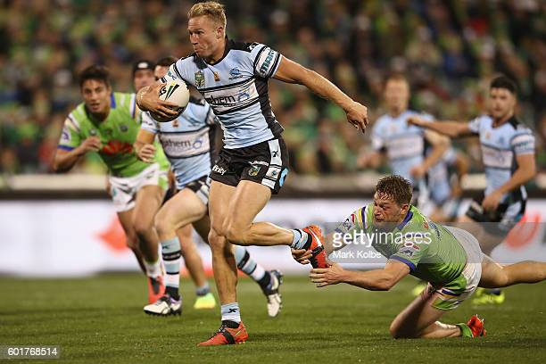 Matt Prior of the Sharks makes a break on his way to score a try during the NRL Qualifying Final match between the Canberra Raiders and the Cronulla...