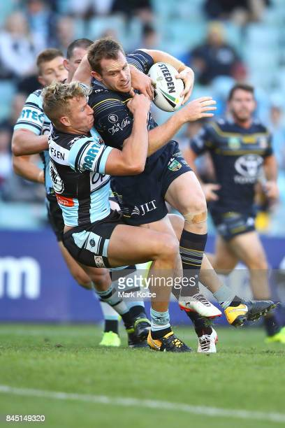 Matt Prior of the Sharks tackles Michael Morgan of the Cowboys during the NRL Elimination Final match between the Cronulla Sharks and the North...