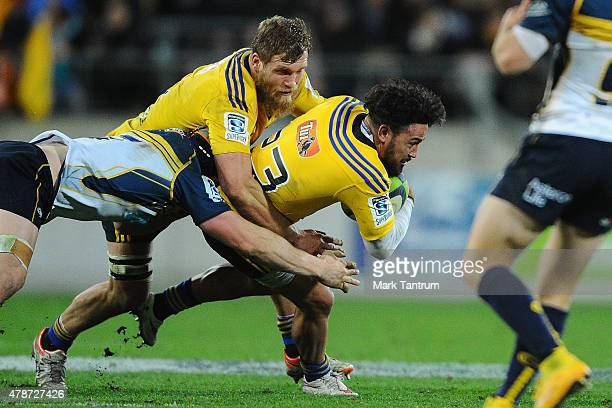 Matt Proctor of the Hurricanes approaches the try line to score a try during the Super Rugby Semi Final match between the Hurricanes and the Brumbies...