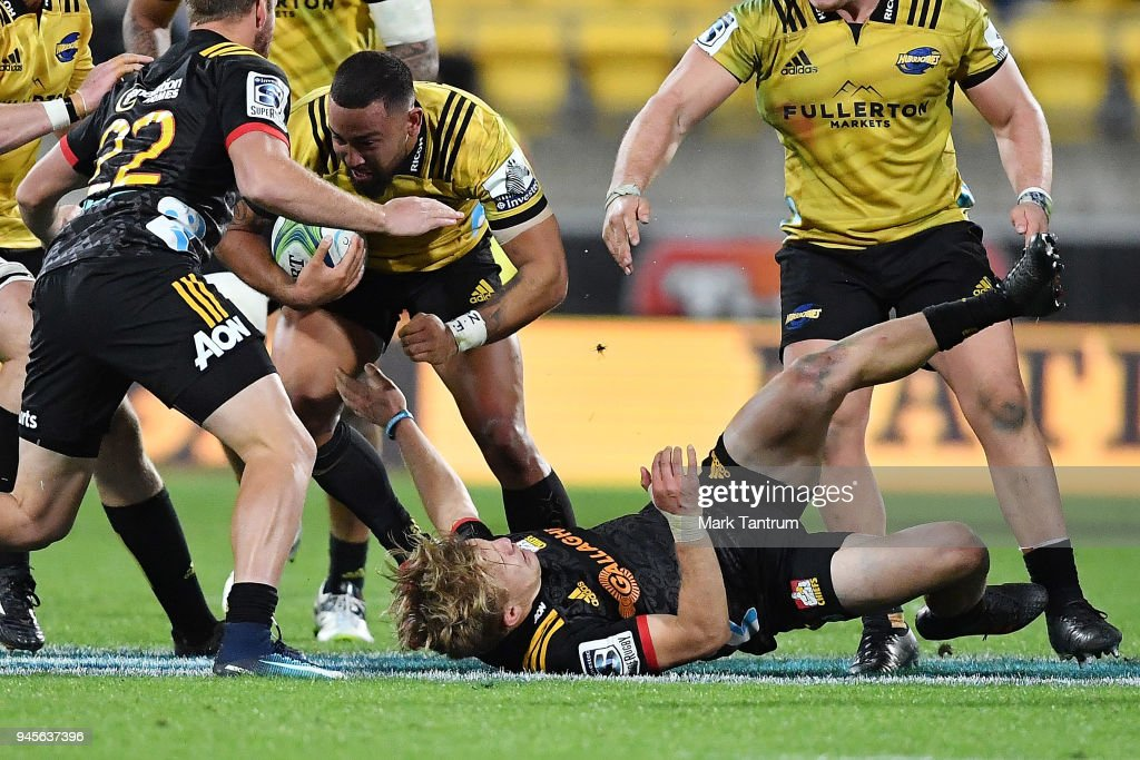 Matt Proctor of the Hurricanes dispatches Damian McKenzie of the Chiefs during the round nine Super Rugby match between the Hurricanes and the Chiefs at Westpac Stadium on April 13, 2018 in Wellington, New Zealand.
