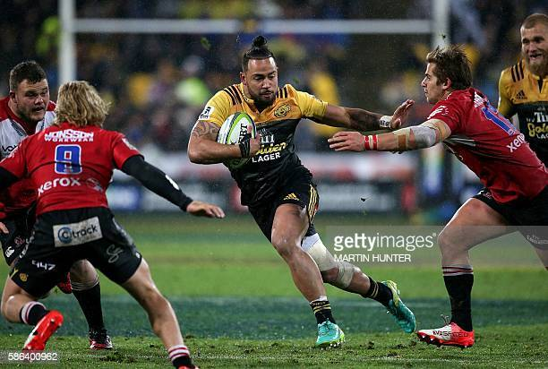 Matt Proctor of the Hurricanes fights off a defender during the Super Rugby final match between the Wellington Hurricanes and Lions of South Africa...