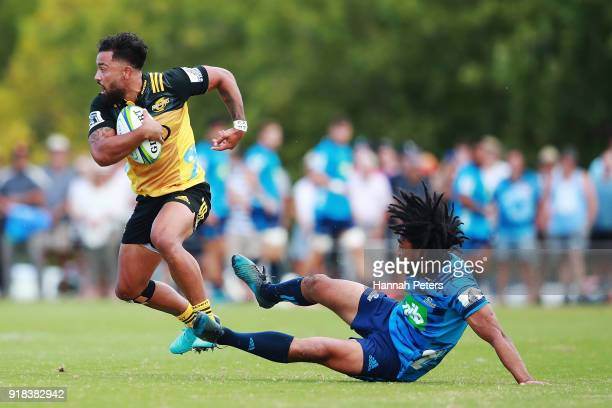Matt Proctor of the Hurricanes makes a break during the Super Rugby trial match between the Blues and the Hurricanes at Mahurangi Rugby Club on...