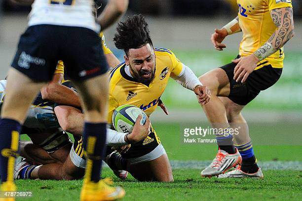 Matt Proctor of the Hurricanes scores during the Super Rugby Semi Final match between the Hurricanes and the Brumbies at Westpac Stadium on June 27...