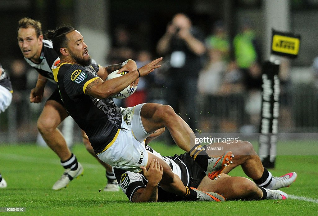 Matt Proctor of Wellington is dragged down during the ITM Cup Premiership Final between Hawke's Bay and Wellington at McLean Park on October 23, 2015 in Napier, New Zealand.