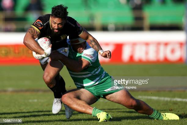 Matt Proctor of Wellington is tackled by Adrian Wyrill of Manawatu during the round six Mitre 10 Cup match between Manawatu and Wellington at Central...