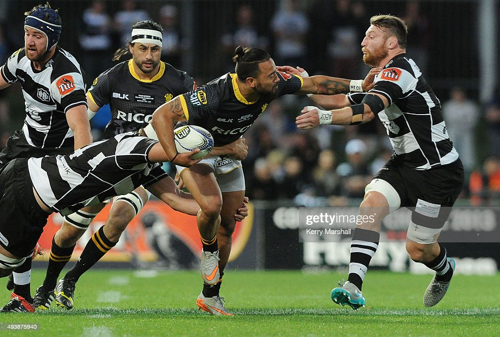 Matt Proctor of Wellington tries to evade Michael Allardice and Tony Lamborn of Hawkes Bay during the ITM Cup Championship Final between Hawke's Bay and Wellington at McLean Park on October 23, 2015 in Napier, New Zealand.