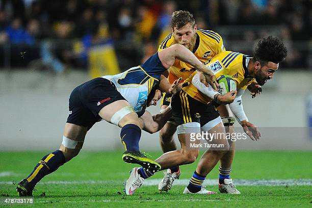 Matt Proctor works through a Brumbies tackle to go on and score a try during the Super Rugby Semi Final match between the Hurricanes and the Brumbies...