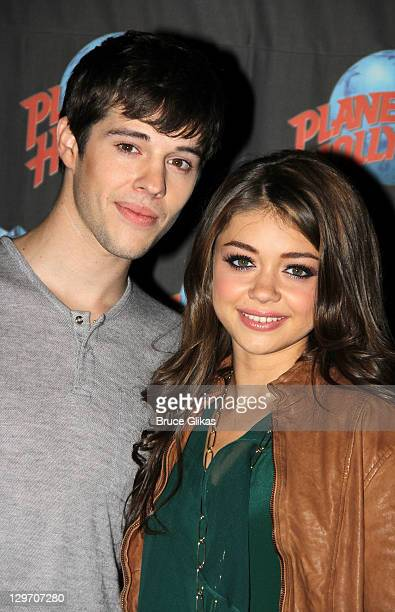 Matt Prokop and Sarah Hyland promote Disney's 'Geek Chaming' as they visit Planet Hollywood Times Square on October 19, 2011 in New York City.