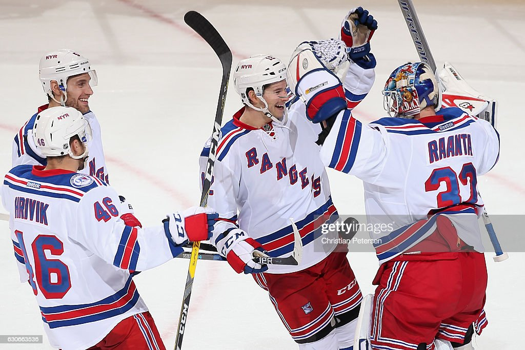 Matt Puempel #12 (C) of the New York Rangers celebrates with goaltender Antti Raanta #32 following the NHL game against the Arizona Coyotes at Gila River Arena on December 29, 2016 in Glendale, Arizona. The Rangers defeated the Coyotes 6-3.