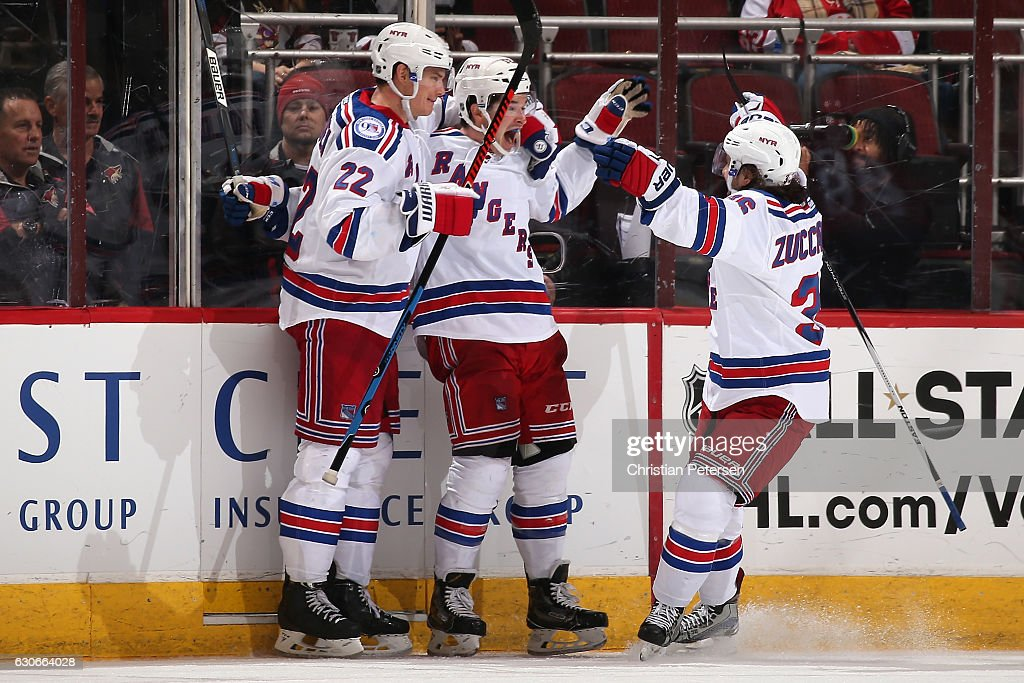 Matt Puempel #12 (C) of the New York Rangers celebrates with Nick Holden #22 and Mats Zuccarello #36 after Puempel scored a goal against the Arizona Coyotes during the third period of the NHL game at Gila River Arena on December 29, 2016 in Glendale, Arizona. The Rangers defeated the Coyotes 6-3.