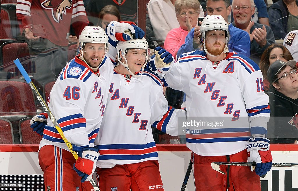 Matt Puempel #12 of the New York Rangers celebrates with teammates Marek Hrivik #46 and Marc Staal #18 after his third goal of the game against the Arizona Coyotes at Gila River Arena on December 29, 2016 in Glendale, Arizona. The Rangers defeated the Coyotes 6-3.