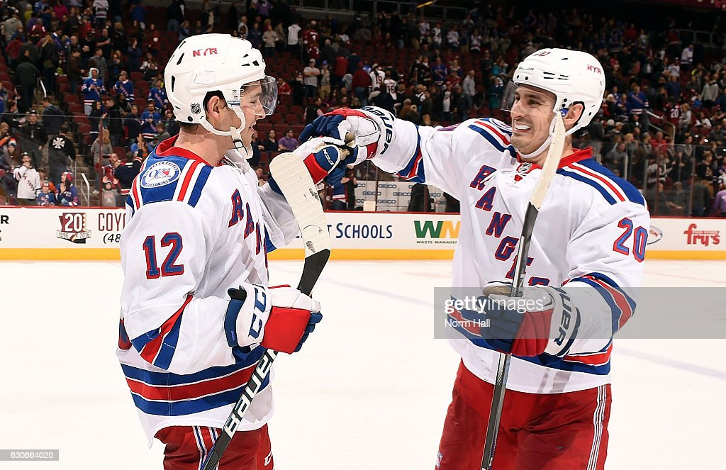 Matt Puempel #12 of the New York Rangers is congratulated by teammate Chris Kreider #20 following a 6-3 victory against the Arizona Coyotes at Gila River Arena on December 29, 2016 in Glendale, Arizona. Puempel had a hat trick in the victory.