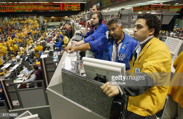 Matt Purcell, Carlos Franco and Nino Mattiacci wait in anticipation of the Federal Open Market Committee rate announcement in the Eurodollar Futures...