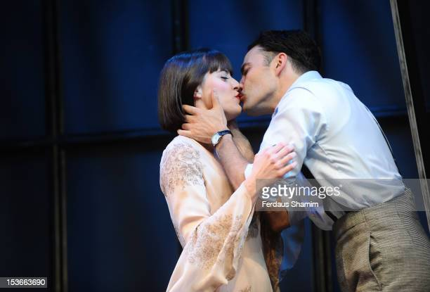 Matt Rawle as Clifford Bradshaw and Michelle Ryan as Sally Bowles perform during a photocall for 'Cabaret' at The Savoy Theatre on October 8 2012 in...