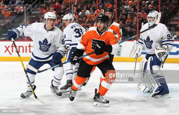 Matt Read and Sean Couturier of the Philadelphia Flyers battle for position in front of the net against Jake Gardiner Auston Matthews and Curtis...