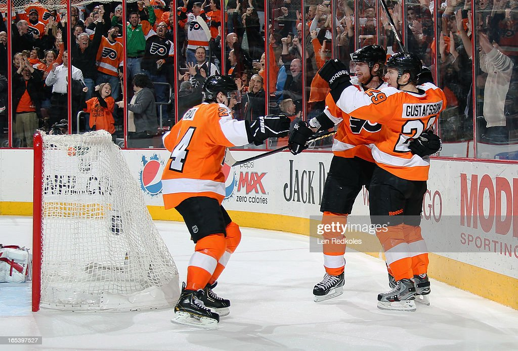 Matt Read #24, Jakub Voracek #93 and Erik Gustafsson #29 of the Philadelphia Flyers celebrate Gustafsson's game-winning goal against the Montreal Canadiens on April 3, 2013 at the Wells Fargo Center in Philadelphia, Pennsylvania. The Flyers won 5-3.