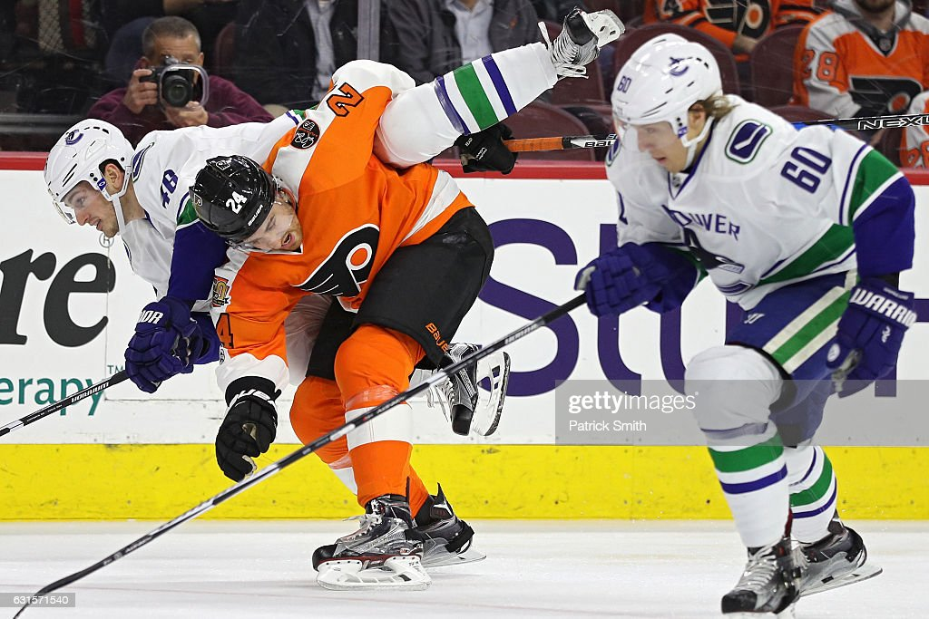 Matt Read #24 of the Philadelphia Flyers bodychecks Jayson Megna #46 of the Vancouver Canucks during the first period at Wells Fargo Center on January 12, 2017 in Philadelphia, Pennsylvania.