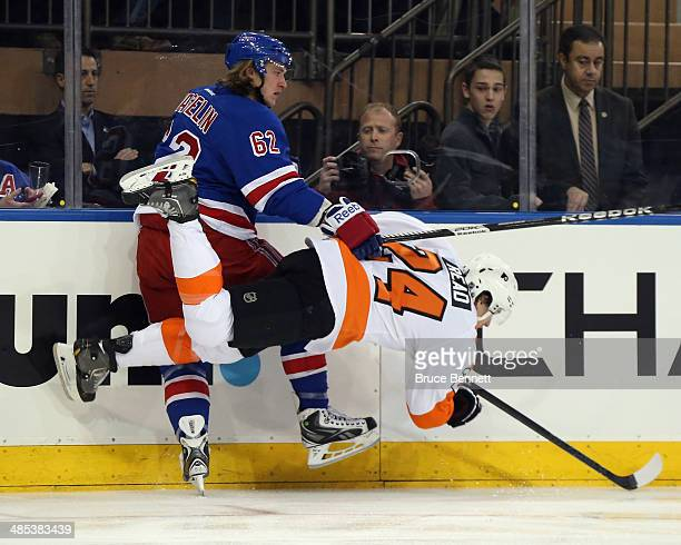 Matt Read of the Philadelphia Flyers bounces off Carl Hagelin of the New York Rangers during the first period in Game One of the First Round of the...
