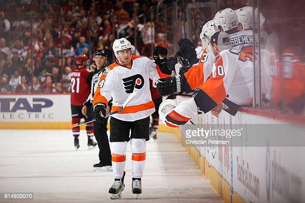 Matt Read of the Philadelphia Flyers celebrates with teammates on the bench after scoring against Arizona Coyotes during the third period of the NHL...