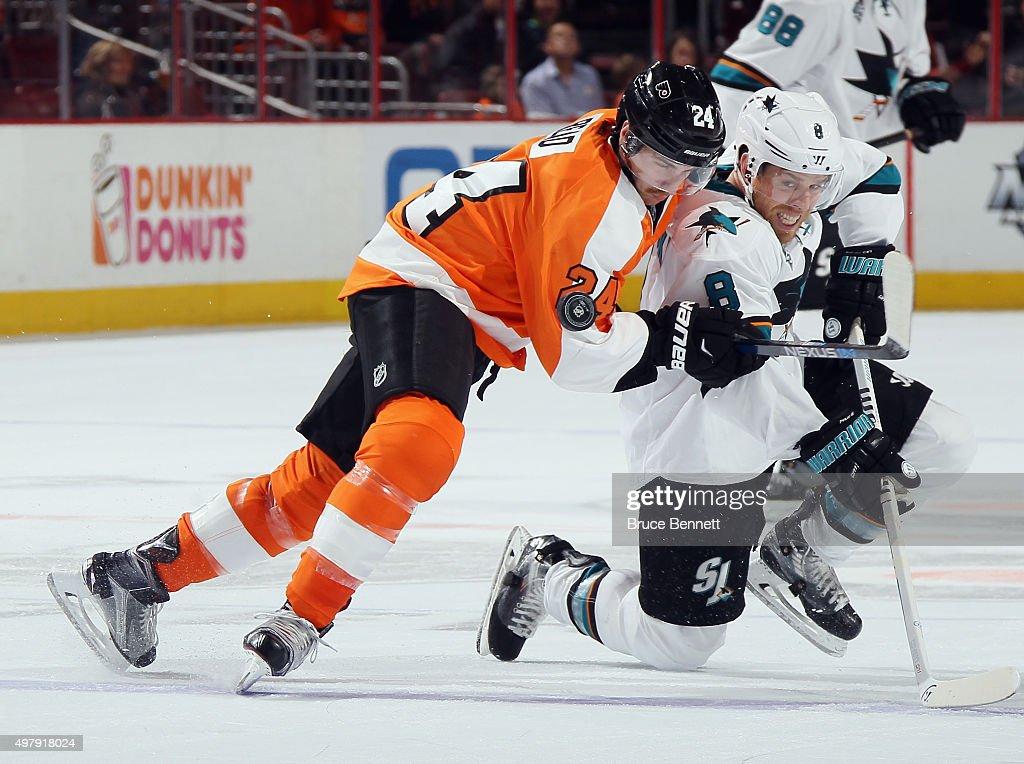 Matt Read #24 of the Philadelphia Flyers checks Joe Pavelski #8 of the San Jose Sharks during the first period at the Wells Fargo Center on November 19, 2015 in Philadelphia, Pennsylvania.