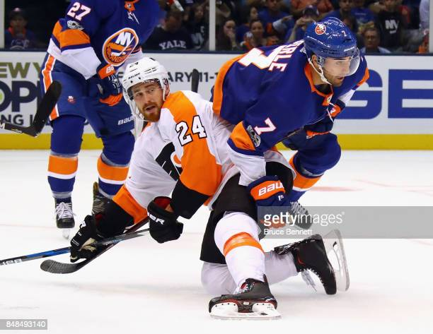 Matt Read of the Philadelphia Flyers colliedes with Jordan Eberle of the New York Islanders during the second period during a preseason game at the...