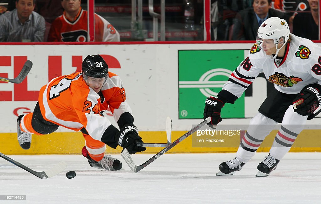 Matt Read #24 of the Philadelphia Flyers dives to play the puck against Patrick Kane #88 of the Chicago Blackhawks on October 14, 2015 at the Wells Fargo Center in Philadelphia, Pennsylvania.