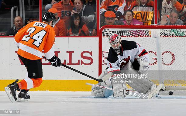 Matt Read of the Philadelphia Flyers scores a shootout goal against Johan Hedberg of the New Jersey Devils on March 15 2013 at the Wells Fargo Center...