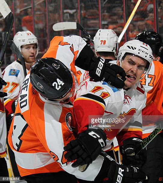 Matt Read of the Philadelphia Flyers scrums with Mikael Backlund of the Calgary Flames on February 29, 2016 at the Wells Fargo Center in...