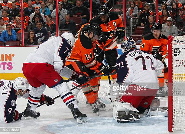 Matt Read, Wayne Simmonds, and Sean Couturier of the Philadelphia Flyers battle in front of goaltender Sergei Bobrovsky of the Columbus Blue Jackets...